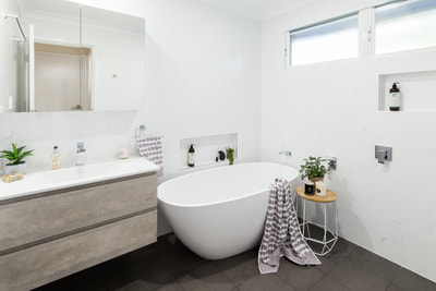 Free standing bath and concrete timber look vanity. Small Bathroom Renovation in Alstonville NSW 2477 By Northern Rivers Bathroom Renovations (NRBR), Ballinas specialist bathroom renovator.