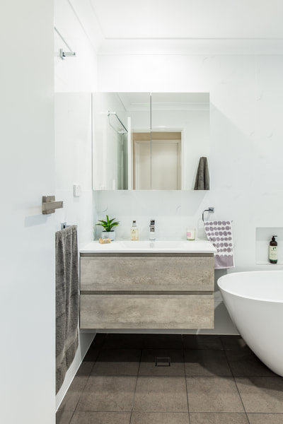 Concrete timber look vanity. Small Bathroom Renovation in Alstonville NSW 2477 By Northern Rivers Bathroom Renovations (NRBR), Ballinas specialist bathroom renovator.