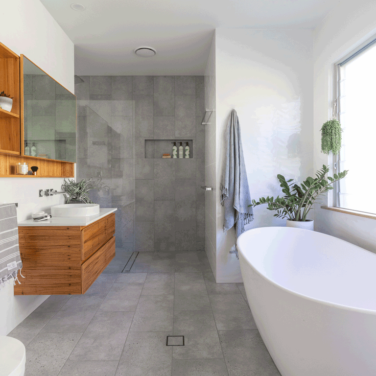 Luxurious Spa like ensuite in Bexhill NSW featuring timber cabinetry and stone bath tub.