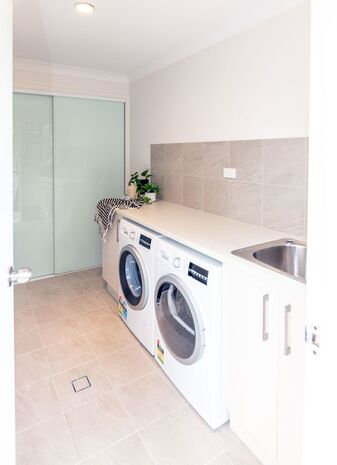 Picture of a modern laundry renovation with a beige colour scheme in Clunes NSW by NRBR
